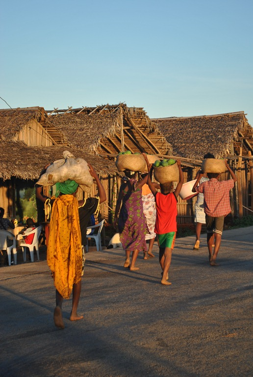 Women in Madagascar carrying food home